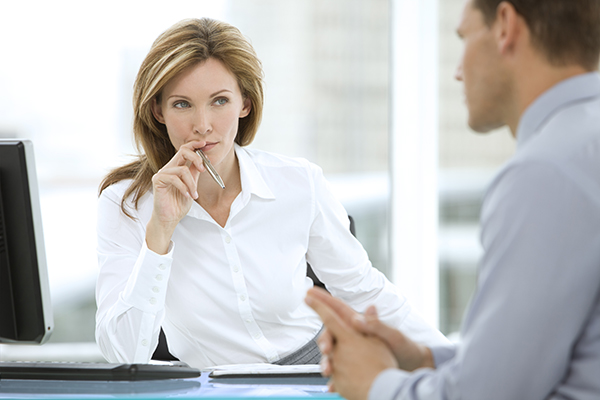 Executive woman listening to businessman